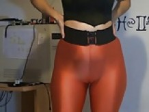 showing her sexy ass in orange leggings
