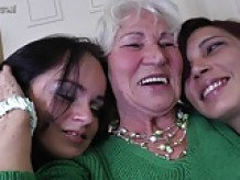 Granny Norma fucks two young lesbian girls