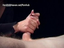 Fat lady in a black dress gives a handjob with oil