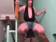 pissing in shorts at an entrance to the stairs